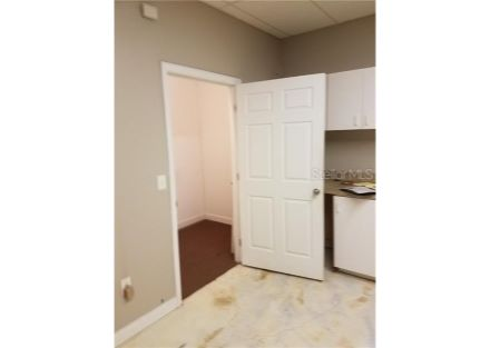 Closet measures approximately 9.5 ft by 5 ft., located off of the multipurpose back room.