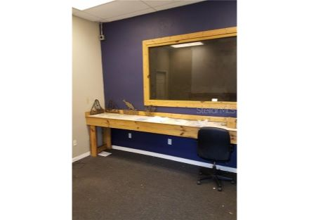 Entrance into Unit #C is into this office with a 14 foot long counter/desk top. Window is into the work booth next to the office