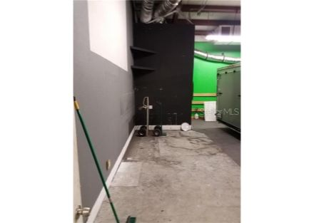 Warehouse/shop area is approximately 28 Ft by 29 Ft, which includes the handicap bathroom in the back left of this photo. Notice