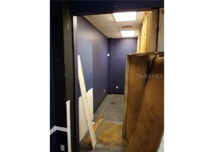 A lighted storage area is alongside the work booth measuring approximately 5 ft by 15 ft.