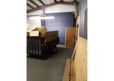 The right side of the warehouse/shop area.  The wall to the right is the wall for the office, work booth and a storage area.  Th