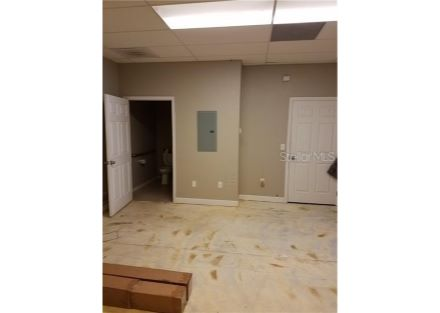 Multipurpose back room, with handicap bathroom to the left and the closet door to the right. The 150 amp electric panel is in th