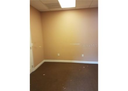Office 1 is approximately 10 ft by 10 ft with 2 doors, one off of the hallway, the other into the reception area.