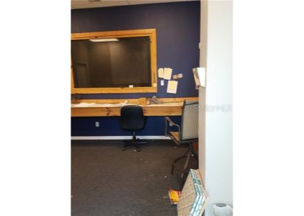 Enter into Unit #C into an office with a counter/desk the length of the 14 ft wall. This wall contains a window into the work bo