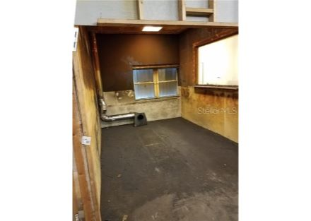 Work Booth is approximately 9.5 ft By 14 Ft, with a vent conduit to the outside.